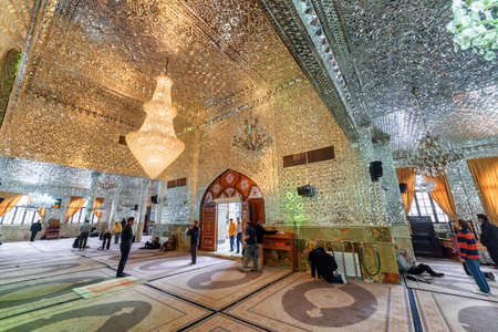 Tehran, Iran - 18 October, 2018: Amazing view of prayer hall in Imamzadeh Saleh at Shemiran district. Ceiling and walls of the Muslim place covered with glass and mirror tiles. Shimmering mosaic. Publikacyjne