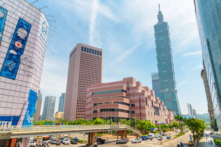 Taipei, Taiwan - April 25, 2019: Fabulous view of intersection of Xinyi Road and Keelung Road on sunny day. Taipei 101 (Taipei World Financial Center) is visible at right. Scenic cityscape.