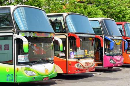 Kaohsiung, Taiwan - April 29, 2019: Scenic view of colorful tourist buses at parking area. Taiwan is a popular tourist destination of Asia.