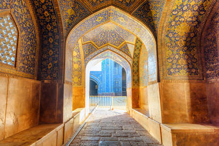 Isfahan, Iran - 23 October, 2018: Awesome vaulted arch corridor leading to courtyard of the Shah Mosque (Imam Mosque). Amazing Persian interior of the Muslim place. Beautiful Islamic architecture. Publikacyjne