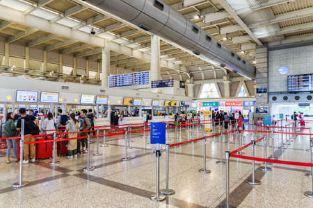 Kaohsiung, Taiwan - May 2, 2019: Check-in desks at departure hall of Kaohsiung International Airport. Interior of international passenger terminal. Taiwan is a popular tourist destination of Asia. Publikacyjne