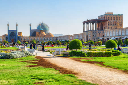 Awesome view of the Shah Mosque (Imam Mosque) and the Ali Qapu Palace at Naqsh-e Jahan Square in Isfahan, Iran. Persian architecture. The square is a popular tourist destination of the Middle East.