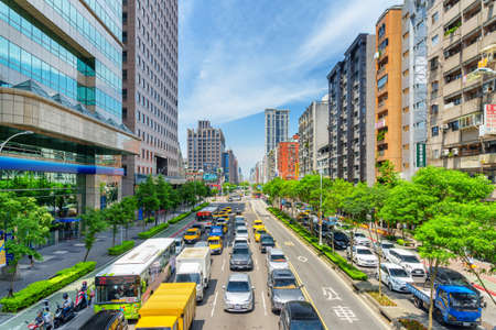 Taipei, Taiwan - April 25, 2019: Fabulous view of Xinyi Road on sunny day. Day traffic of Taipei. Scenic cityscape. Taiwan is a popular tourist destination of Asia. Publikacyjne