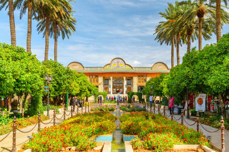 Shiraz, Iran - 29 October, 2018: Awesome view of Qavam Historical House and scenic colorful traditional Persian garden. The historical house is a popular tourist attraction of the Middle East.