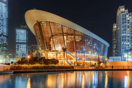 Dubai, United Arab Emirates - 2 November, 2018: Awesome night view of Dubai Opera House at downtown. The Opera District is a popular tourist destination of UAE.
