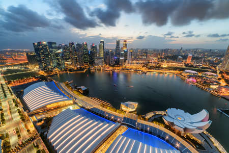 Wonderful aerial view of Marina Bay and skyscrapers of downtown in evening. Amazing Singapore skyline. Fantastic cityscape. Singapore is a popular tourist destination of Asia.