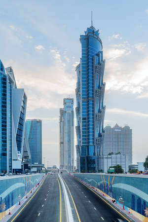 Dubai, United Arab Emirates - 2 November, 2018: Amazing evening view of skyscrapers at Happiness Street of Business Bay. Awesome cityscape. Dubai is a popular tourist destination of UAE.
