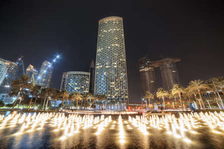 Dubai, United Arab Emirates - 2 November, 2018: Awesome night view of scenic fountain, skyscrapers and other contemporary buildings of downtown. Dubai is a popular tourist destination of UAE.