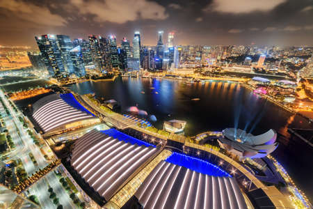 Gorgeous night aerial view of Marina Bay and skyscrapers of downtown. Awesome Singapore skyline. Fantastic cityscape. Singapore is a popular tourist destination of Asia.
