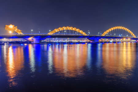 Beautiful night view of the Dragon Bridge (Cau Rong) over the Han River at downtown of Da Nang (Danang), Vietnam. Fabulous cityscape. The Dragon Bridge is a popular tourist attraction of Asia. Stock fotó