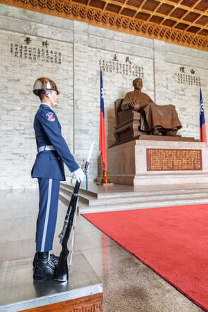 Taipei, Taiwan - April 23, 2019: Guard and statue of Chiang Kai-shek inside the main chamber of the National Chiang Kai-shek Memorial Hall. The memorial hall is a popular tourist destination of Asia.