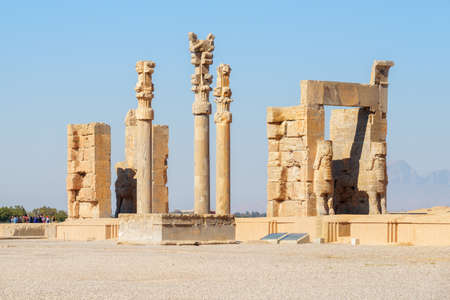 Amazing ruins of the Gate of All Nations on blue sky background in Persepolis, Iran. Ancient Persian city. Persepolis is a popular tourist destination of the Middle East.