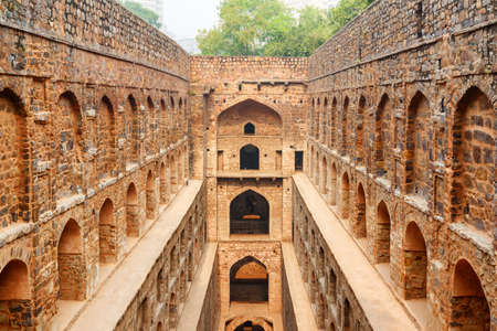 Amazing view of Agrasen ki Baoli reservoir in Delhi, India. The ancient step well is a popular tourist attraction of South Asia. Beautiful architecture of historical monument with arched niches.