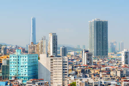 Amazing view of old residential buildings and modern high-rise buildings in Macau. Awesome cityscape. Macau is a popular tourist destination of Asia and leading casino market of the world.