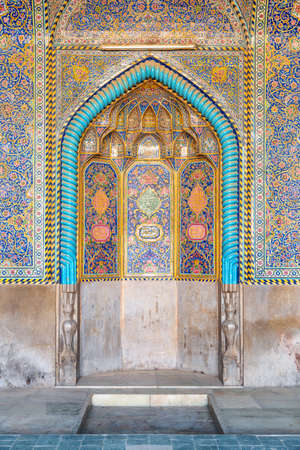 Isfahan, Iran - 24 October, 2018: Gorgeous view of mihrab inside Seyyed Mosque. Walls covered with colorful mosaic and calligraphic inscriptions. Awesome Islamic interior.