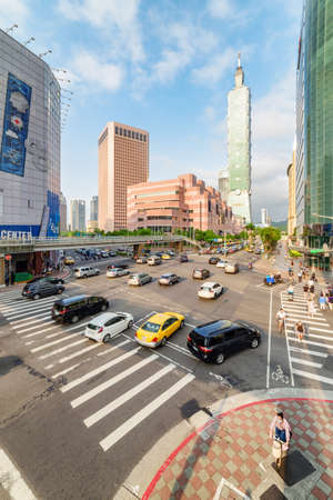 Taipei, Taiwan - April 26, 2019: Amazing evening view of intersection of Xinyi Road and Keelung Road at downtown. Taipei 101 (Taipei World Financial Center) is visible at right. Day traffic. Redakční