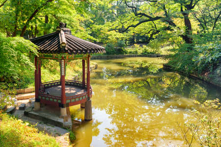 Seoul, South Korea - October 13, 2017: Amazing view of colorful pavilion in Huwon Secret Garden of Changdeokgung Palace. Traditional Korean architecture. The garden is a popular tourist attraction.