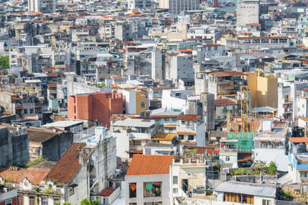 Aerial view of old residential buildings in Macau. Amazing cityscape. Macau is a popular tourist destination of Asia and leading casino market of the world. Stock Photo