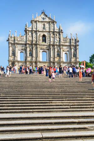 Macau - October 18, 2017: Beautiful view of the Ruins of St. Pauls on blue sky background. Macau is a popular tourist destination of Asia and leading casino market of the world.