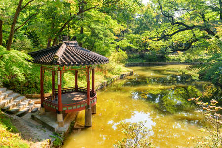 Seoul, South Korea - October 13, 2017: Awesome view of colorful pavilion in Huwon Secret Garden of Changdeokgung Palace. Traditional Korean architecture. The garden is a popular tourist attraction.