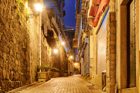 Scenic night view of deserted narrow street at old town of Macau. Historic Centre of Macao is a popular tourist attraction of Asia.