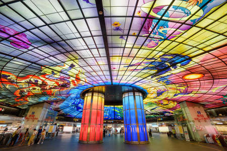 Kaohsiung, Taiwan - May 1, 2019: Gorgeous colorful interior view of the Formosa Boulevard Station of the Kaohsiung MRT system at downtown. The Dome of Light is the largest glass work in the world.