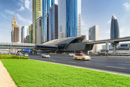 Gorgeous view of skyscrapers at downtown of Dubai, United Arab Emirates (UAE). Day traffic of Sheikh Zayed Road. Financial Centre Station of the Dubai Metro. Amazing cityscape on sunny day.