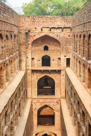 View of Agrasen ki Baoli reservoir in Delhi, India. The ancient step well is a popular tourist attraction of South Asia. Beautiful architecture of historical monument with arched niches. 写真素材