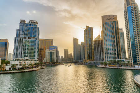 Dubai, United Arab Emirates - 2 November, 2018: Gorgeous view of Dubai Marina at sunset. Scenic artificial canal and high-rise residential buildings. Dubai is a popular tourist destination of UAE. 스톡 콘텐츠