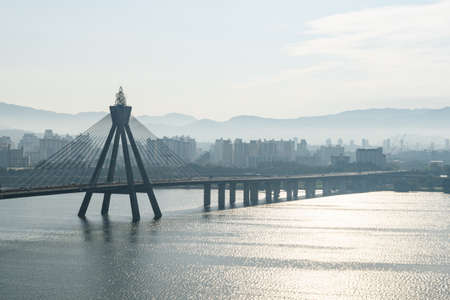 Wonderful view of Bridge over the Han River (Hangang) at downtown of Seoul in South Korea. Scenic cityscape. Seoul is a popular tourist destination of Asia.