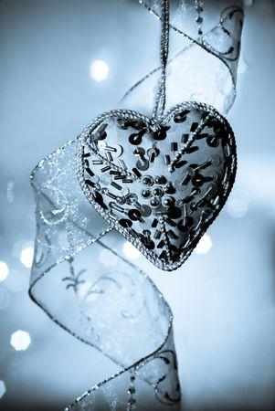 detai: blue heart and silver ribbon