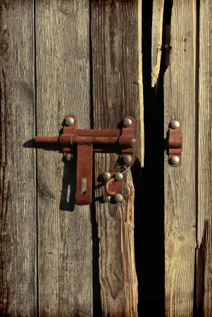 transom: old wooden door with bolt Stock Photo