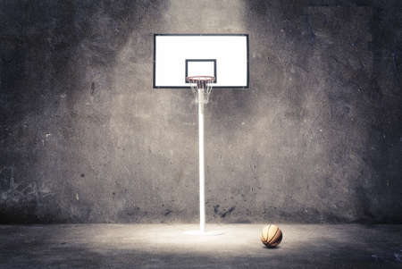 basketball dunk: Basketball hoop on a textured wall with a ball. Stock Photo