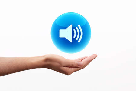 volume glow light: Sphere sound icon on hand Stock Photo