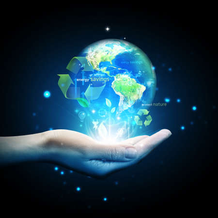 World globe on hand with energy saving concept Stock Photo