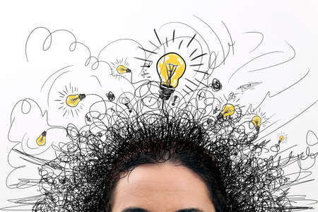 confusion: Thinking people with question signs and light idea bulb above Stock Photo