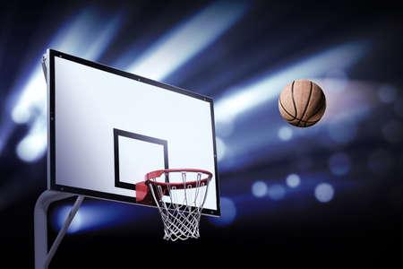スポット ライトとフープを見出しバスケット ボール 写真素材