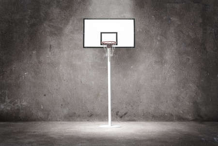 spotlight white background: Basketball hoop on a textured wall