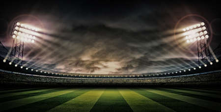 soccer ball on grass: Stadium dark night