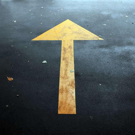pattern: arrow on asphalt