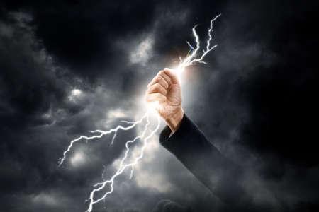 business woman hand clenching lightning flash 스톡 콘텐츠