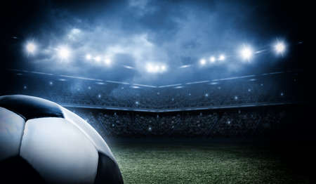 football players: balón de fútbol en el estadio