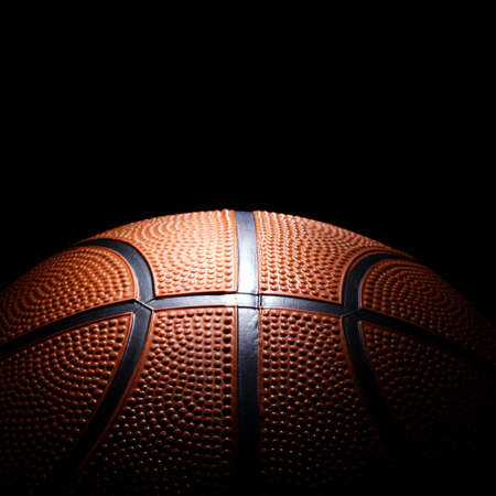Photo of basketball on black background. Stock Photo