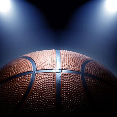 スポット ライトとバスケット ボールの写真