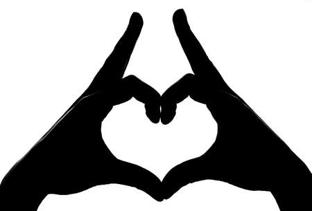 black hands: making heart shape with hands silhouette Stock Photo