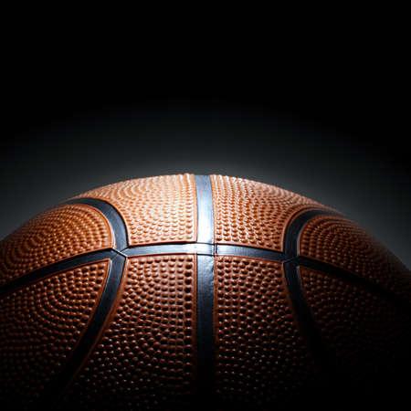background basketball court: Photo of basketball on black background. Stock Photo