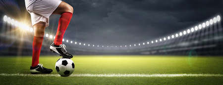 Football player in the stadium, the imaginary soccer stadium is modelled and rendered. Imagens