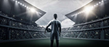 The football player in the stadium, the imaginary soccer stadium is modeled and rendered. 写真素材