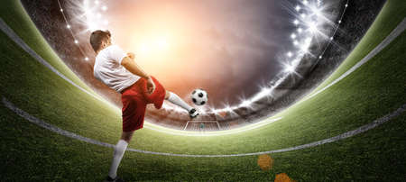 Football player in the stadium, the imaginary soccer stadium is modelled and rendered.