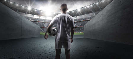 The football player in the stadium.The imaginary football stadium is modelled and rendered.